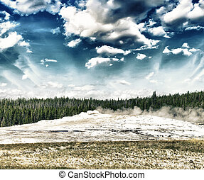 Starting eruption of Old Faithful geyser at Yellowstone National Park.