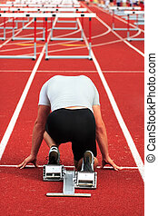 Starting line - A man is in the starting blocks ready for a...