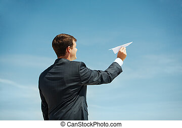 Starting new business - Photo of businessman holding paper...