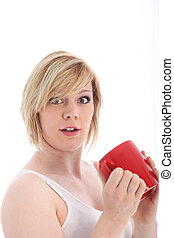 Startled woman holding a mug of coffee