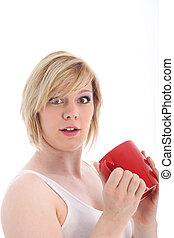 Startled woman holding a mug of coffee