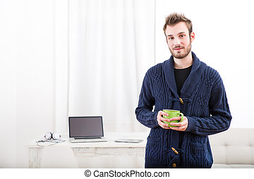 Startup at home - A young man starting his business from...