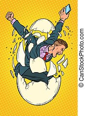 startup business birth concept. businessman appears from the shell of an egg