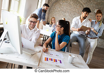 Startup business team on meeting in modern bright office interior brainstorming, working on computer