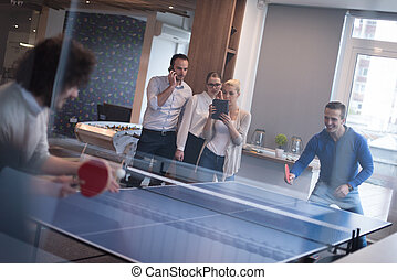 startup business team playing ping pong tennis - group of ...