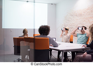 startup business team using virtual reality headset - ...