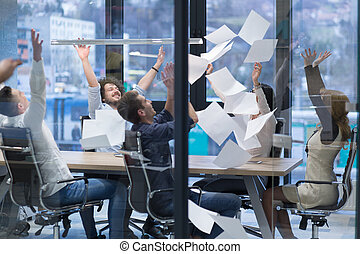 startup Group of young business people throwing documents -...