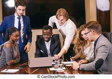 business team on meeting in modern office brainstorming, working on laptop