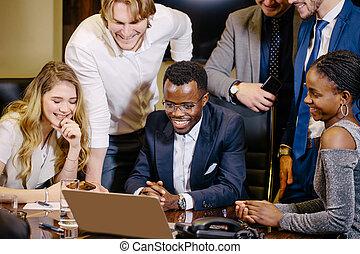 business team on meeting in modern office brainstorming, working on laptop