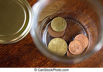 Stash of Greek euro coins in a jar