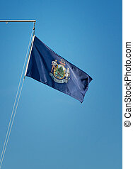 State flag of Maine against blue sky