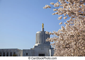State of Oregon Capitol with Golden Pioneer Statue on Top at...