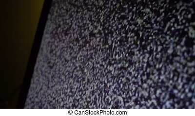 Static noise of flickering detuned TV or monitor screen