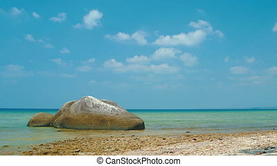 Static shot - Tropical seashore with rock