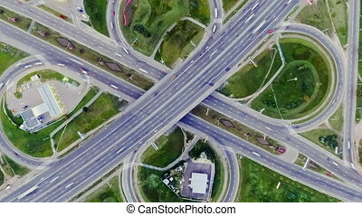 Static vertical top down aerial view of traffic on freeway...