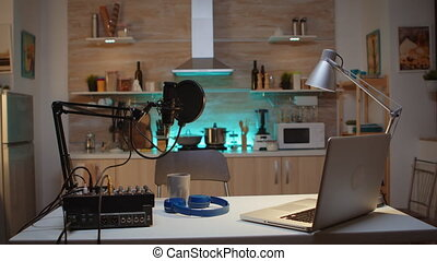 Station for recording and speaking during podcast. Influencer recording social media content with production microphone. Digital web internet streaming station