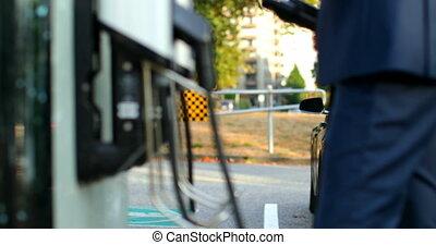 station, homme affaires, 4k, voiture, électrique, charger
