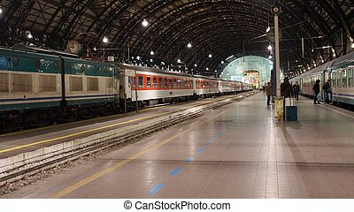 Trains stopped at platform in railway station, Milano Centrale, Italy - (16:9 ratio)