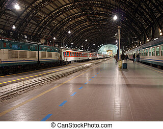 Trains stopped at platform in railway station, Milano Centrale, Italy