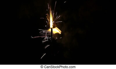 Stationary and Moving Sparklers - Two Sparklers Throwing Off...