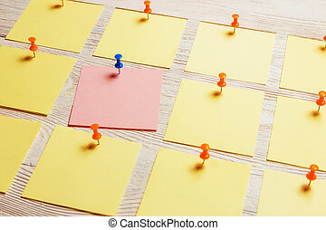 Stationary, Blank Colored Sticker Pined on White Wooden Board. Time-management, Planning.