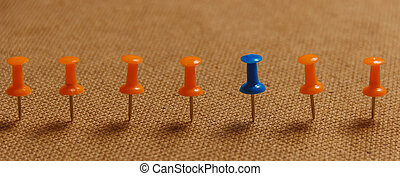 Stationary, Blue Pushpin in Row with Orange, Concept for Difference, Individuality, Leadership. Copy Space. Banner.
