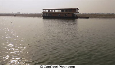 Stationary Houseboat in Ganga River, India - Wide low-angle...