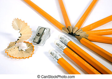 stationary - pencils and sharpener on isolated background
