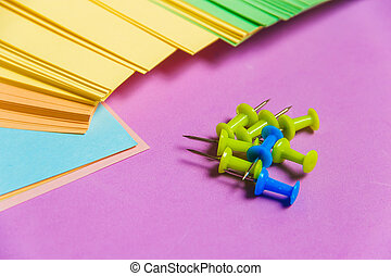 Stationary, Pushpins Heap, Blank Colored Sticker on Lilac Board. Time-management, Planning.