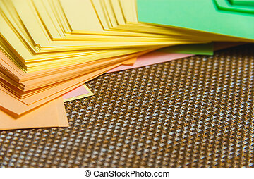 Stationary, Stack of Blank Colored Sticker on Brown Board. Time-management, Planning.