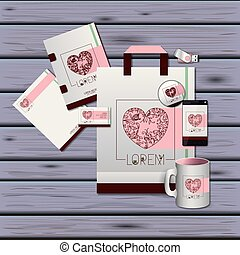 stationary templates of heart design of business stationery over violet wooden background