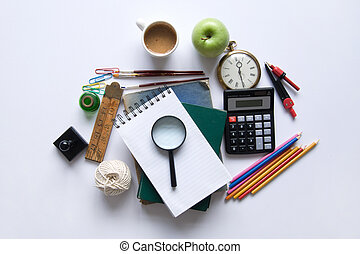 Various stationery objects on a white table