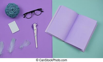 Stationery for creativity and work stop motion on a colored background. Fun animation of things movement, a color scheme of lavender and turquoise. Art creativity concept