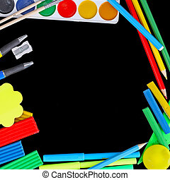 Stationery isolated on a black background.