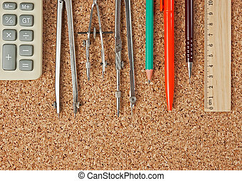 stationery on the cork board
