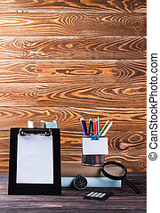 Stationery on wooden table.