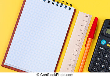 Stationery on yellow background.