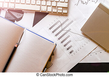 Statistical data. Diagrams graphs and financial documents reviewing on table. Analytics and financial background.