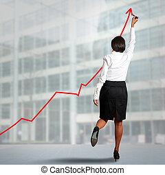 Statistics - Businesswoman drawing statistics in a wall