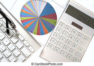 Statistics elements in a desk with calculator and keyboard