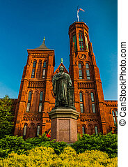 Statue and bushes in front of the Smithsonian Castle, in the...