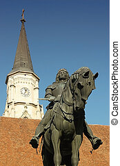 Statue and church in Cluj Napoca - Statue of King Mathias...