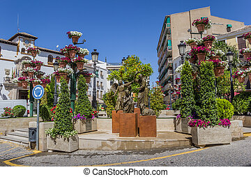 Statue and flowers on the central square of Alcaudete