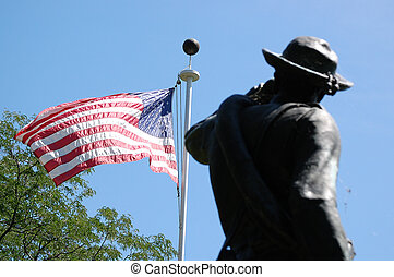 Statue and Old Glory