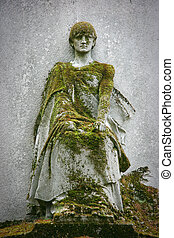Statue covered with moss