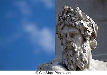 Statue head - A marble head and a blue sky on background