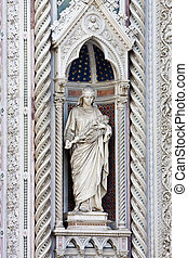 Statue in Alcove of Facade