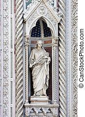 Statue in Alcove of Facade