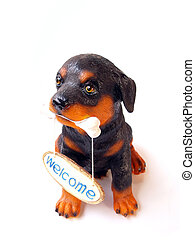 statue of a dog sitting on white background