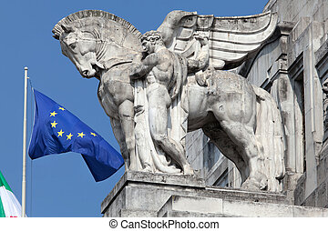 Statue of a man holding a winged horse on the Milan's main...